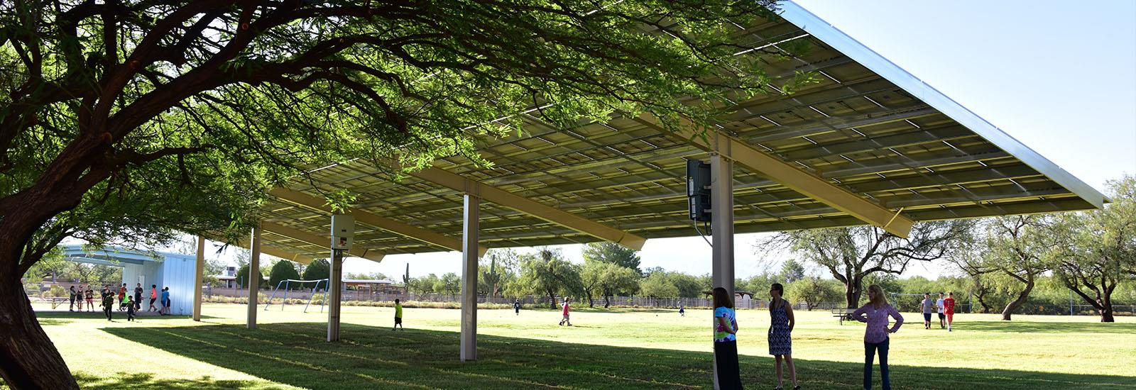Solar panels offer shade cover in our play area.